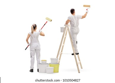 Female painter and a male painter climbed up a ladder painting isolated on white background