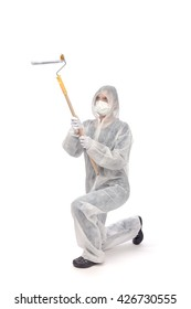 female painter in white disposable suit and protective mask with paint roller isolated on white background