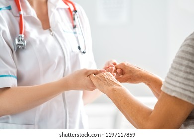 Female patient listening to doctor in medical office.