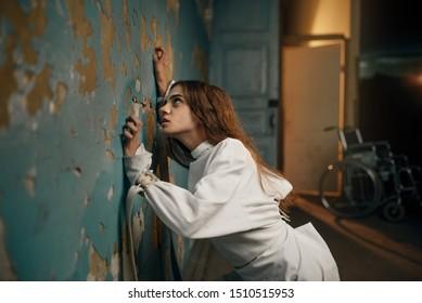 Female patient in strait jacket, insanity