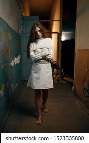 Female patient in straitjacket, mental hospital