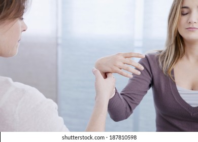 Female patient taking part in hypnotherapy