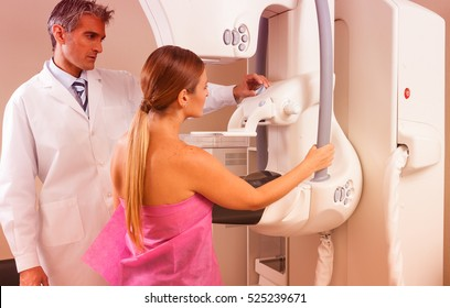 Female patient undergoing mammography test in hospital.