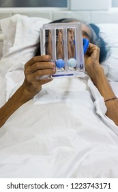 Female patient using Tri-ball Incentive Spirometer to practice deep breathing on the bed. Medical concept;treatment patient.