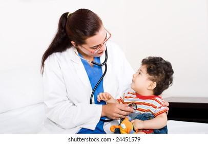female pediatrician checking cute baby boy