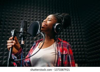 Female performer songs in audio recording studio