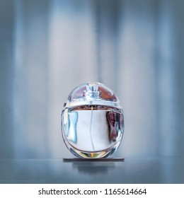 Female perfume fragrance. Blue background with copy space.