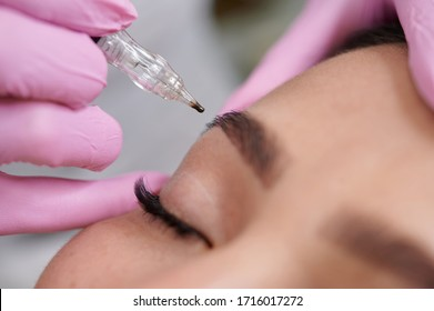 Female permanent eyeliner tattoos enhancement coloring in spa