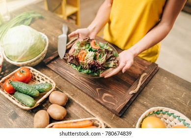Female person cooking salad, healthy organic food