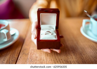 Female person hand with golden wedding ring