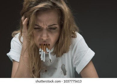 Female person with revolting expression expectorating rollups of mouth. Isolated on background