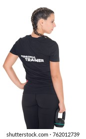 Female Personal Trainer, with her back facing the camera, isolated
