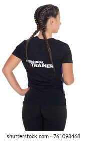 Female Personal Trainer, with his back facing the camera, isolated