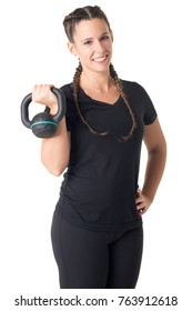 Female Personal Trainer, holding a kettlebell, isolated