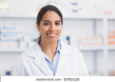 Female pharmacist smiling in hospital
