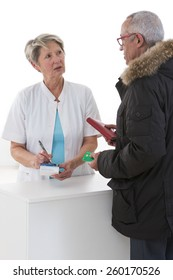 Female pharmacist talking to patient about the medical prescription