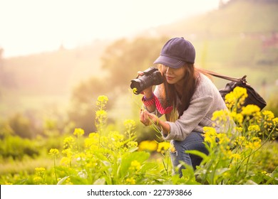 Female photographer at flower field