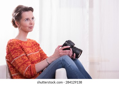 female Photographer sitting in armchair