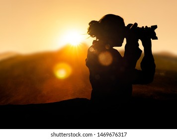 Female Photographer at sunrise in the mountains