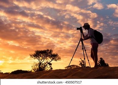 Female photographer. Travel and adventure concept.