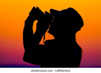Female photographer, young reporter, Silhouette of female photographer