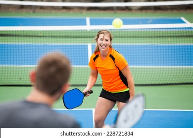 Female Pickleball player on the court.