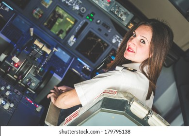 Female Pilot in the Airplane Cockpit
