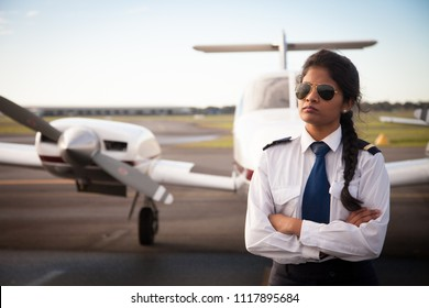 Female Pilot by Her Aircraft