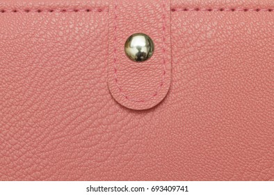 female pink purse texture closeup