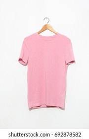 female pink shirt on hanging isolated