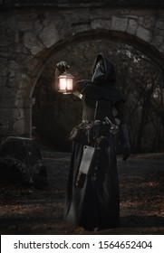 female plague doctor with lamp at the castle gates