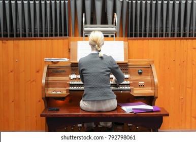 Female playing organ.
