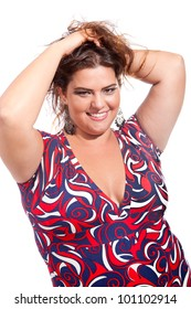 Female Plus size model posing in the studio, fashion portrait, on white background. The woman is smiling in a happy manner. Good for concept of health, happiness, dieting, obesity, weight loss.
