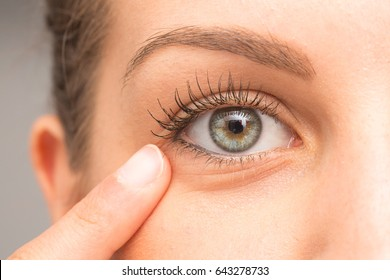 Female pointing eye bag with finger