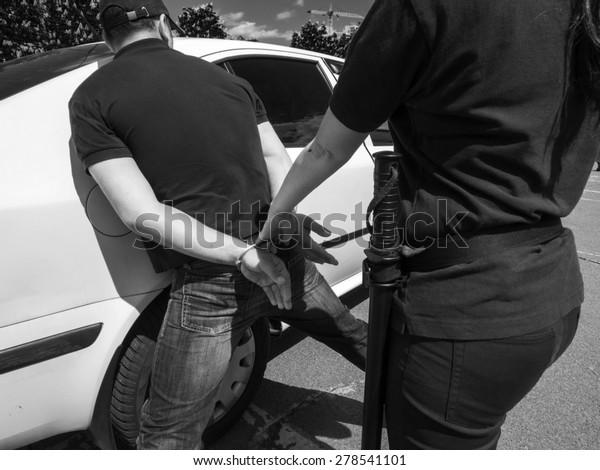 female police officer arrests a criminal