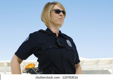 A female police officer standing outdoors
