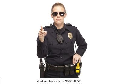 Female police officer in sunglasses pointing finger
