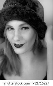 Female portrait. 1940's vintage retro style. wearing dark hat. Smiling. UK