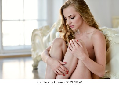 Female portrait of cute lady indoors. Close-up beautiful sexy model girl in elegant pose. Beauty blonde woman with hairstyle