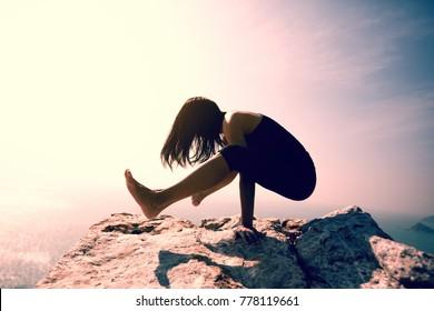 female practicing yoga arm-balance handstand Crane