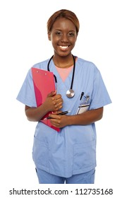 Female practitioner ready to assist senior doctor. Holding clipboard and smiling at camera
