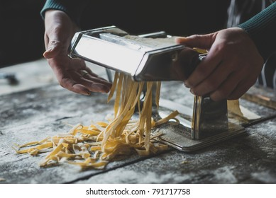 Female preparing Italian traditional tagliatelle pasta,selective focus