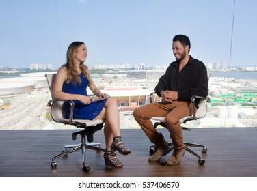 Female presenter asking a famous female celebrity at tv studio