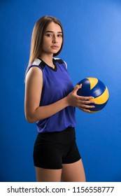 Female professional volleyball player isolated on blue