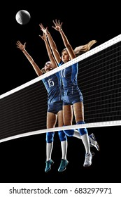 Female professional volleyball players isolated on black