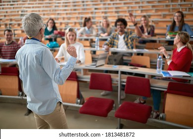 Female professor lecturing the students in amphitheatre