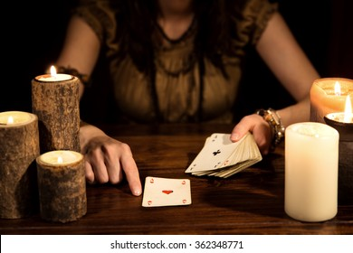 Female psychic is telling the future with playing cards, concept tarot and numerology
