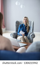 Female psychologist conducting a consultation. Family psychologist.