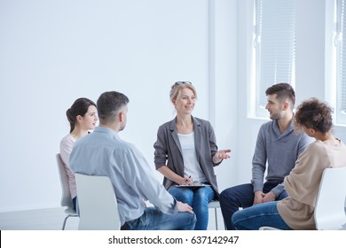 Female psychotherapist talking with her group during session
