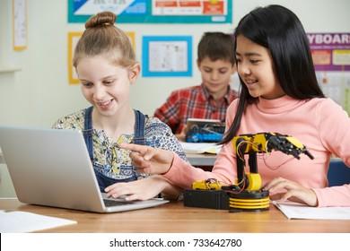 Female Pupils In Science Lesson Studying Robotics